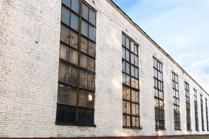 Facade of an old industrial factory building. wide angle view. stock image