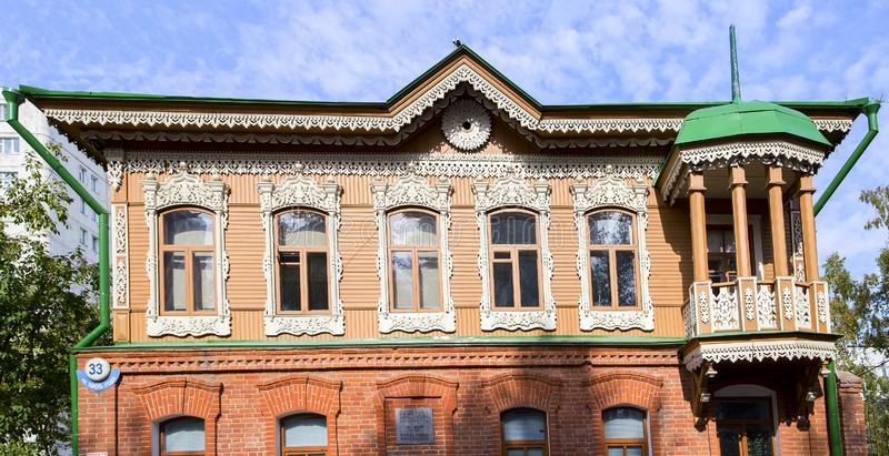 The facade of the old restored house with carved platbands. Horizontally royalty free stock photo