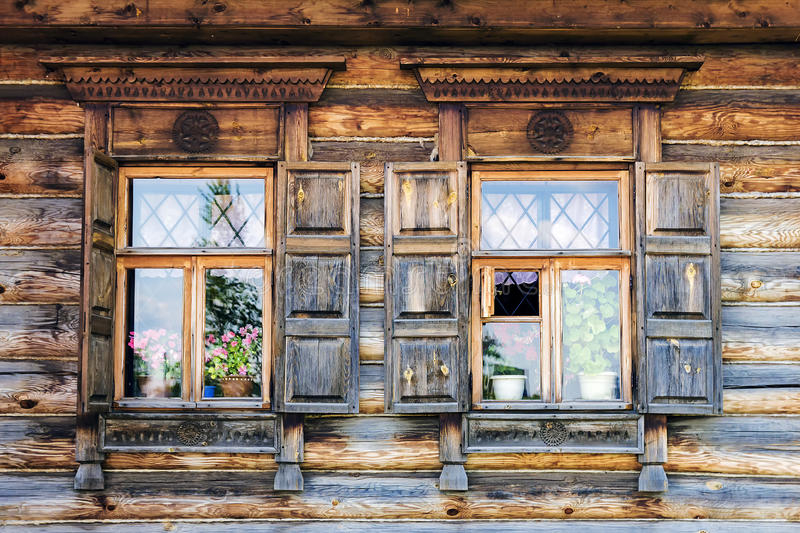 Facade of the old Russian log houses in Suzdal stock photo