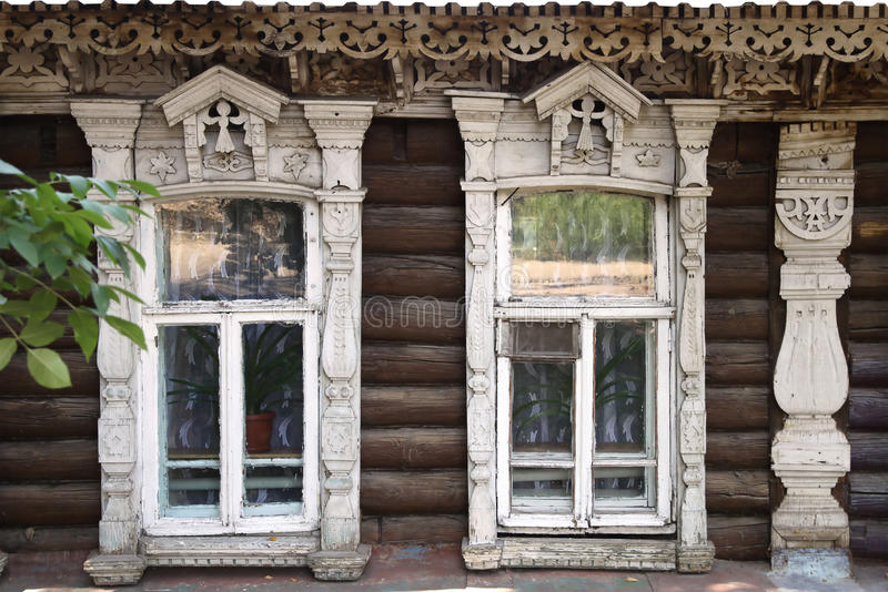 The facade of the old wooden houses with carved architraves royalty free stock photos