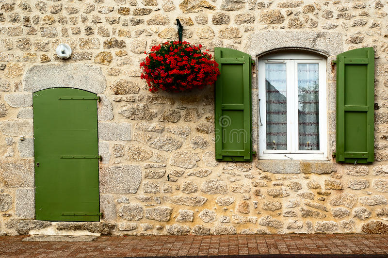 Facade olive green color and flowers royalty free stock images
