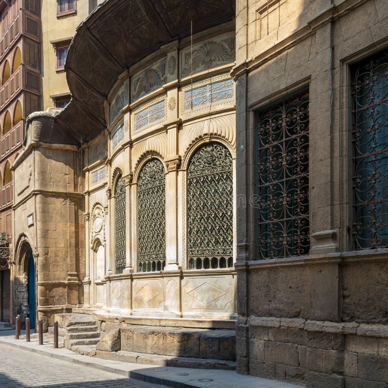 Facade of Ottoman era historic Soliman Agha El Silahdar complex, Moez Street, Old Cairo, Egypt. Moez Street with facade of Ottoman era historic Soliman Agha El stock image