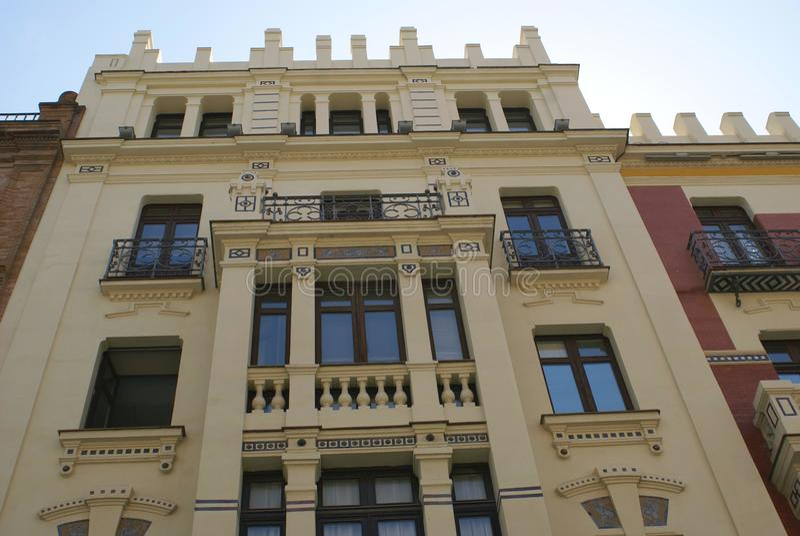 Facade. Outdoor view of a facade with window balconies in Spain stock photography