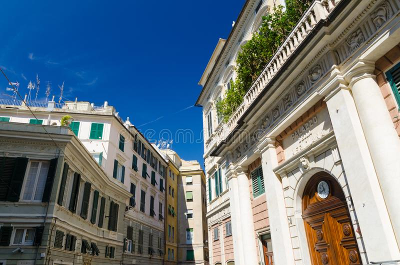 Facade of palace Palazzo Grimaldi della Meridiana classic style building. With watch on doors on Piazza della Meridiana square in historical centre of old royalty free stock images