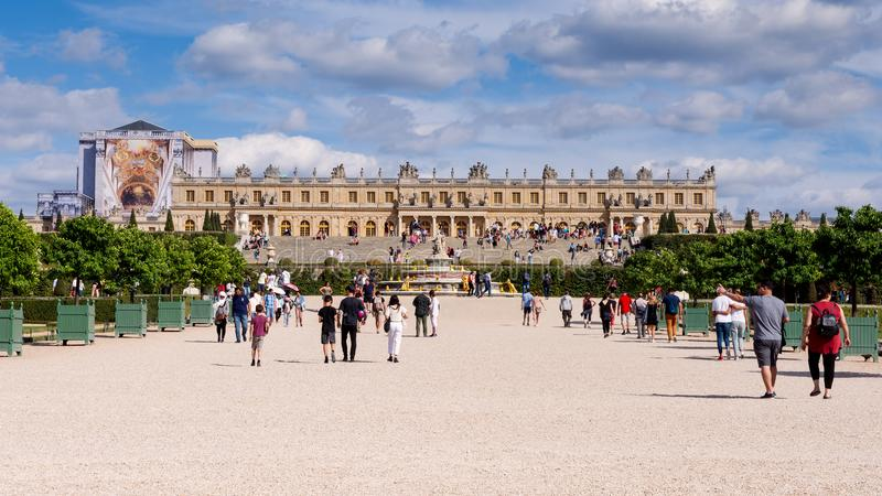 The Palace of Versailles near Paris. The facade of the Palace of Versailles and the crowd of tourists royalty free stock images