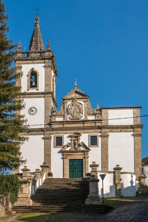 Church of Sao Joao Baptista. The facade of the parish church of Sao Joao Baptista combines the Mannerist and Baroque styles and a prominence of the Baptism of royalty free stock photo