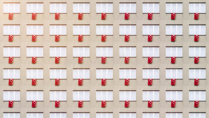 Facade pattern with Turkish flags. And windows royalty free stock photos