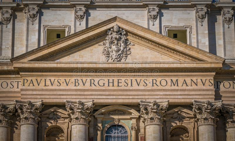 Facade with Paulus V coat of arms, Saint Peter Basilica in Rome, Italy. stock photography