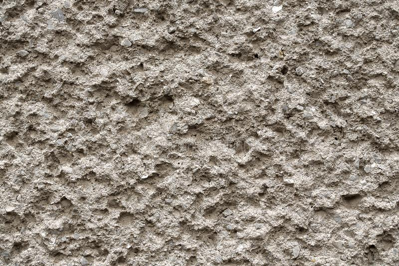 Facade plaster texture in slovak called Brizolit. Single layer sprayed cement plaster wallpaper. Single-ply monolithic plaster. Facade plaster texture in slovak royalty free stock photo