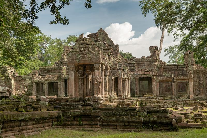 Facade of Preah Khan framed by trees royalty free stock image
