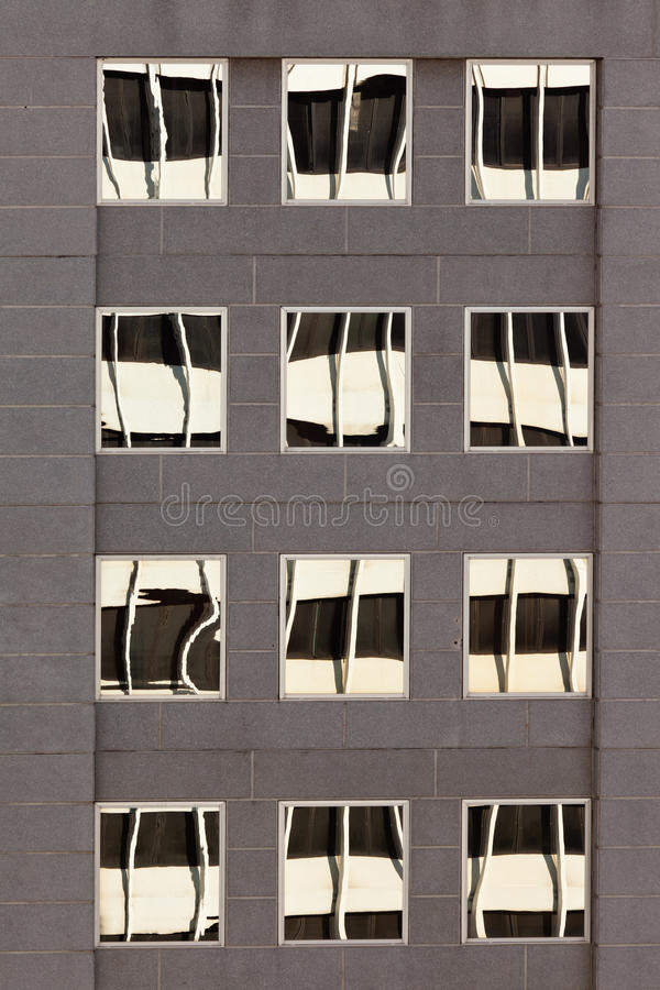 Facade with reflections of building on windows royalty free stock images