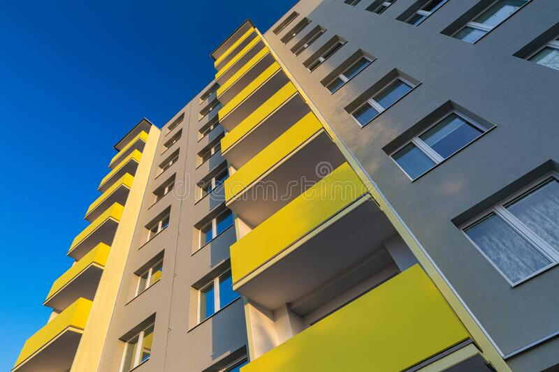 Facade of a renovated apartment block of flats. With balconies stock image