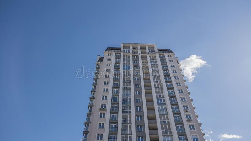Facade of a residential building fragment low angle view against the sky.  stock images