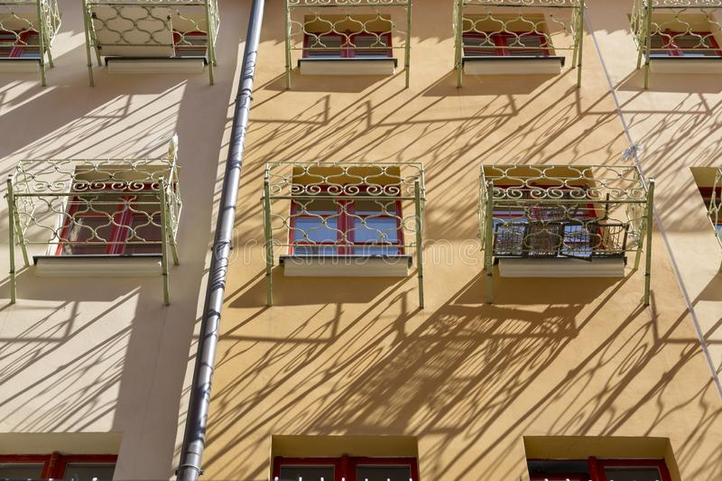 Facade of a residential building with small balconies in front of the window.  royalty free stock image