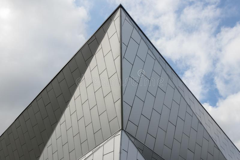 Facade and roof of a modern metal building. Geometric lines and patterns are abstract architectural background stock image