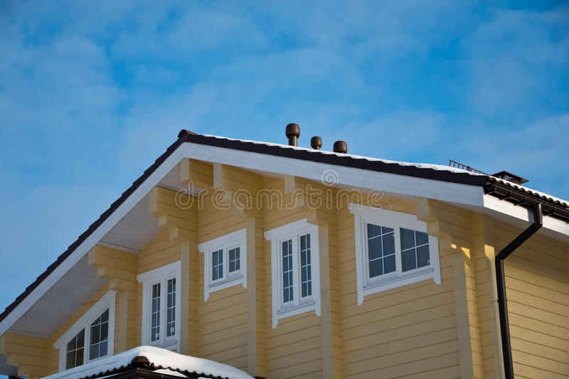 Facade and roof of a modern wooden house royalty free stock photography