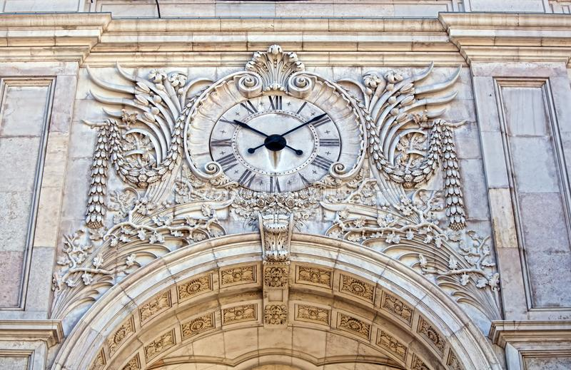 Facade of the Rua Augusta Triumphal Arch with its clock face.  royalty free stock photo