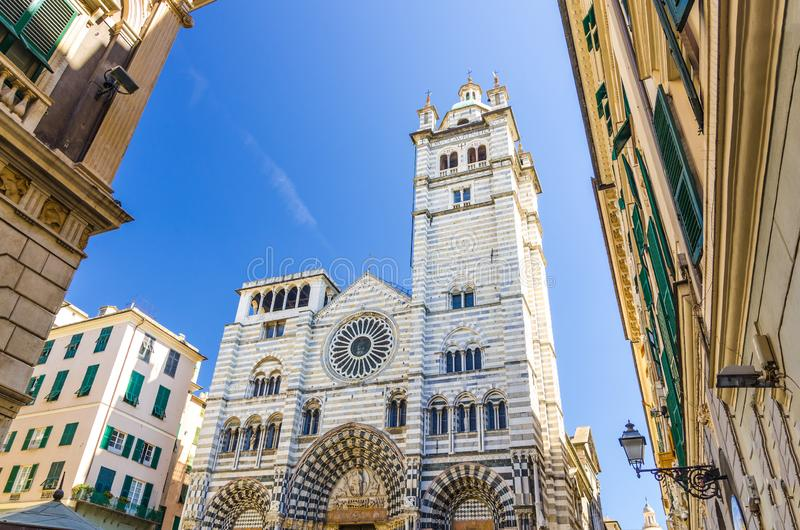 Facade of San Lorenzo Cathedral catholic church on Piazza San Lorenzo square. Among buildings in historical centre of old european city Genoa Genova with blue royalty free stock images