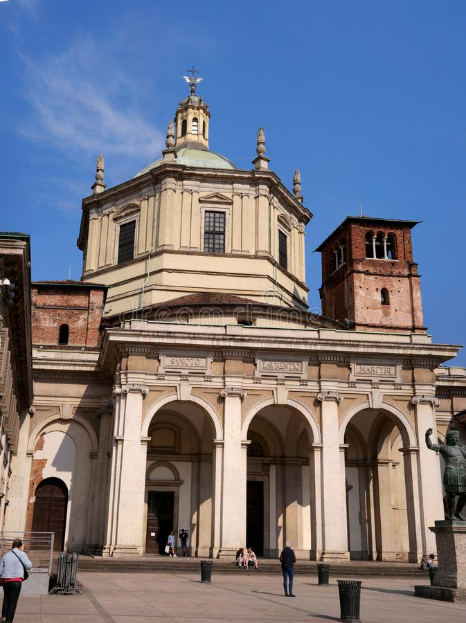 Facade of San Lorenzo Maggiore Basilica -Saint Lawrence the Major Cathedral- and statue of Constantine emperror in front stock photo