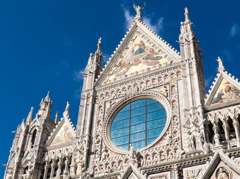 Facade of Siena dome Duomo di Siena royalty free stock photography