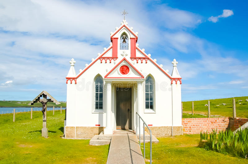 Facade of a small rural church in the countryside - The italian chapel, UK royalty free stock photography