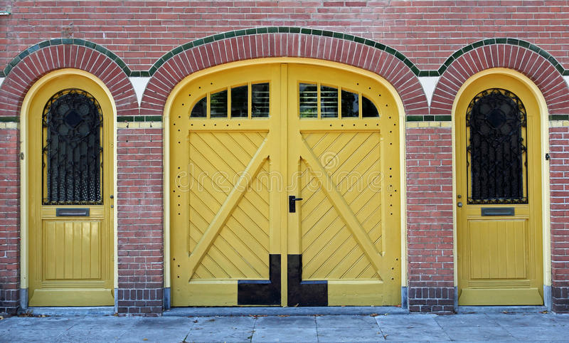 Facade with three doors stock photography