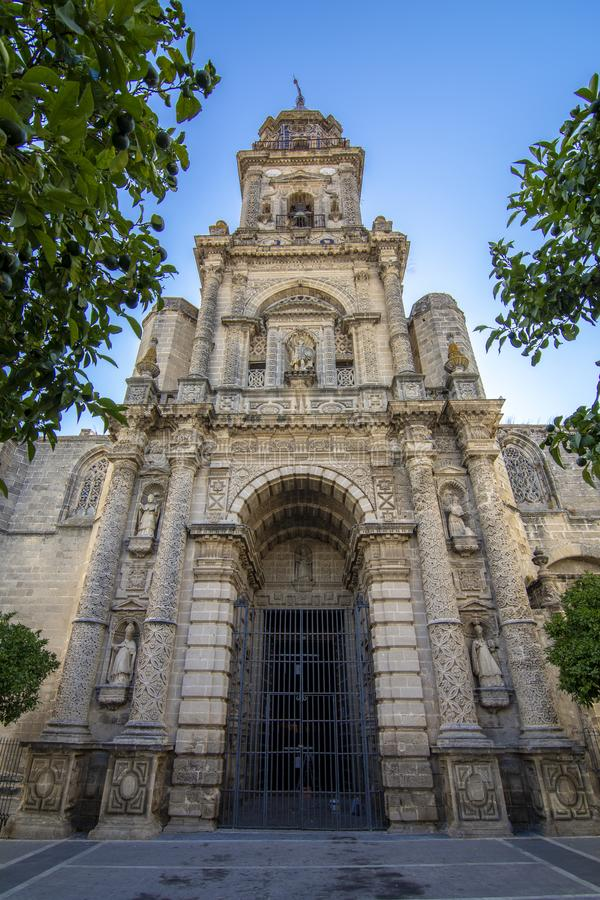 Facade and tower of the Church of San Miguel in Jerez de la Frontera royalty free stock photography