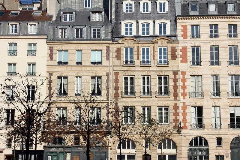 Facade of a traditional apartment building in Paris stock photo
