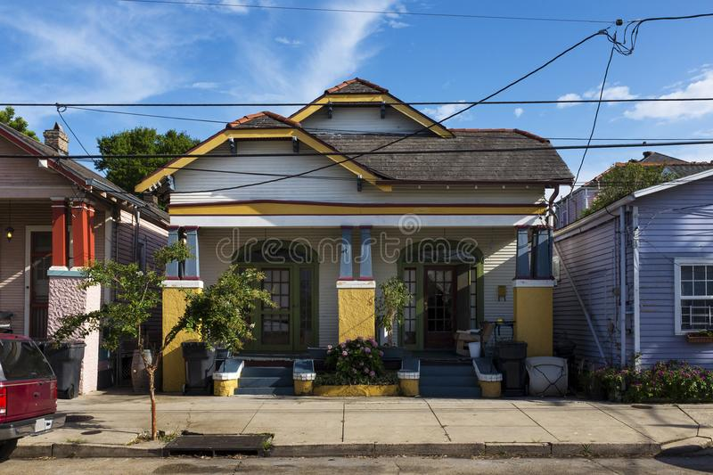 The facade of a traditional colorful house in the Marigny neighborhood in the city of New Orleans, Louisiana royalty free stock photo