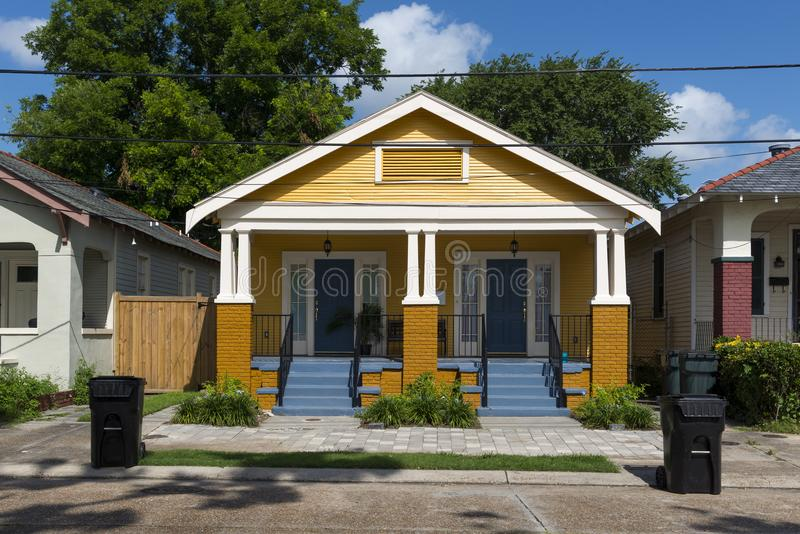 The facade of a traditional colorful house in the Marigny neighborhood in the city of New Orleans, Louisiana stock photo