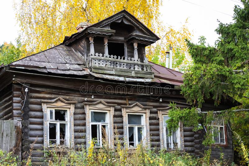 Facade of a traditional Russian house made of wooden logs izba with a balcony in autumn. Gorokhovets. Vladimir oblast, Russia stock photography