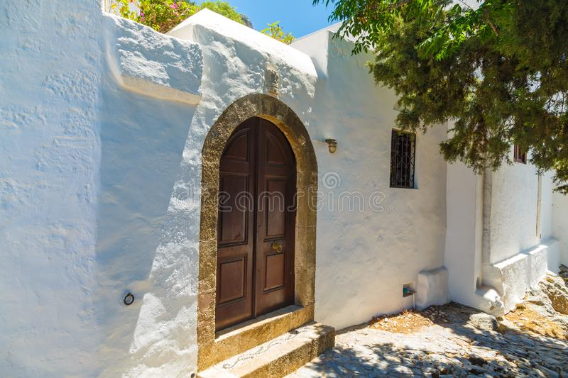 Facade of traditional white house in the Lindos town at Rhodes island. Facade of traditional white house in Lindos town at Rhodes island stock photography