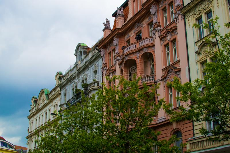 Facade of a typical colorful classic building in a street in middle of Prague, Czech Republic.  royalty free stock photo