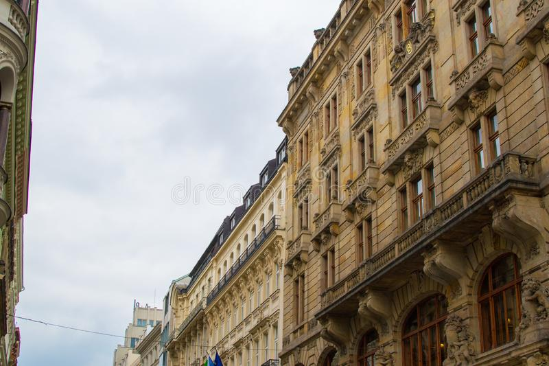 Facade of a typical colorful classic building in a street in middle of Prague, Czech Republic.  stock images