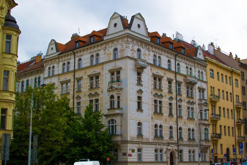 Facade of a typical colorful classic building in a street in middle of Prague, Czech Republic.  royalty free stock photography