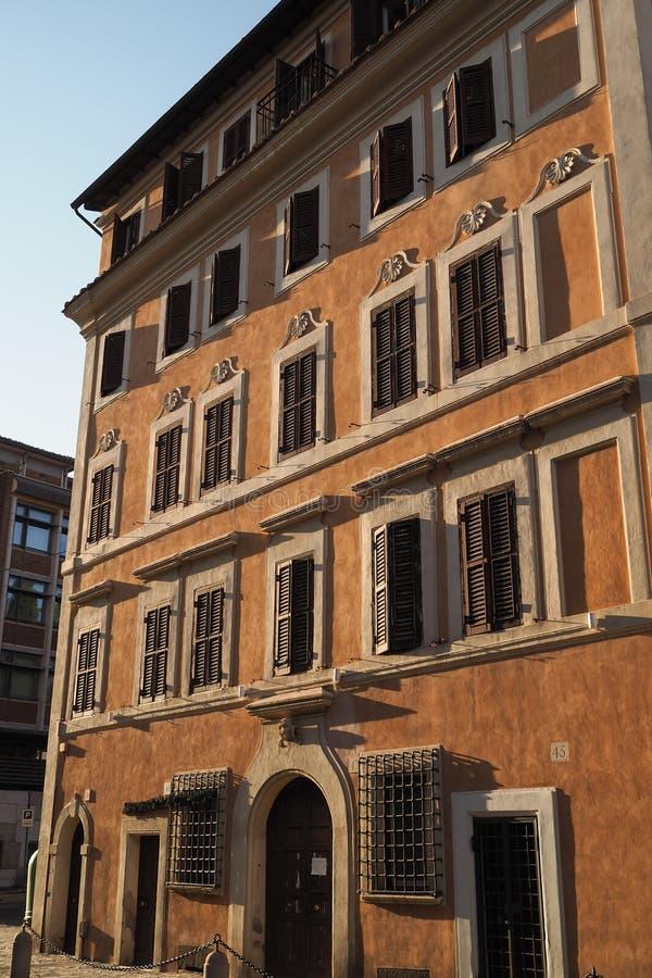 Facade of a typical Italian building with orange facade royalty free stock photos