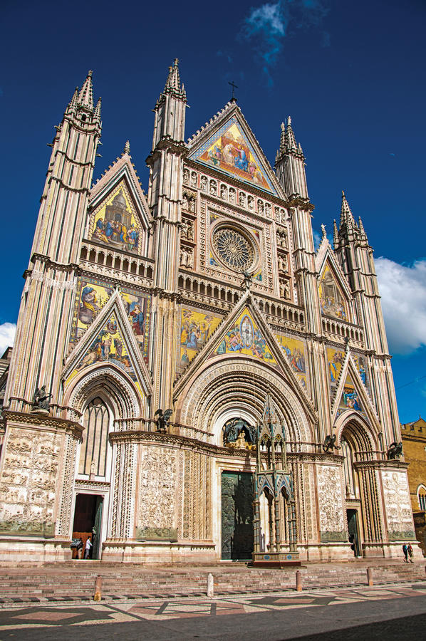 Facade view of the opulent and monumental Orvieto Cathedral in Orvieto. Facade view of the opulent and monumental Orvieto Cathedral Duomo under sunny blue sky stock photography