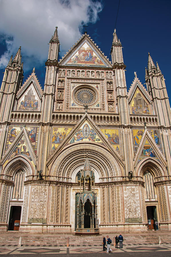 Facade view of the opulent and monumental Orvieto Cathedral in Orvieto. Orvieto, Italy - May 17, 2013. Facade view of the opulent and monumental Orvieto royalty free stock images