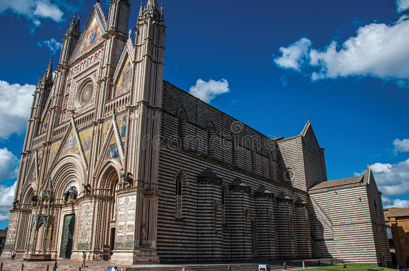Facade view of the opulent and monumental Orvieto Cathedral in Orvieto. Orvieto, Italy - May 17, 2013. Facade view of the opulent and monumental Orvieto stock photography