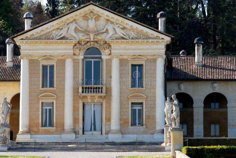Facade of villa with four massive columns stock photos