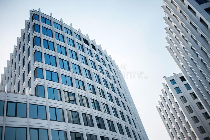 Facade of white buildings in the business quarter. Not fully glass facades. Perspective, direction forward royalty free stock photos