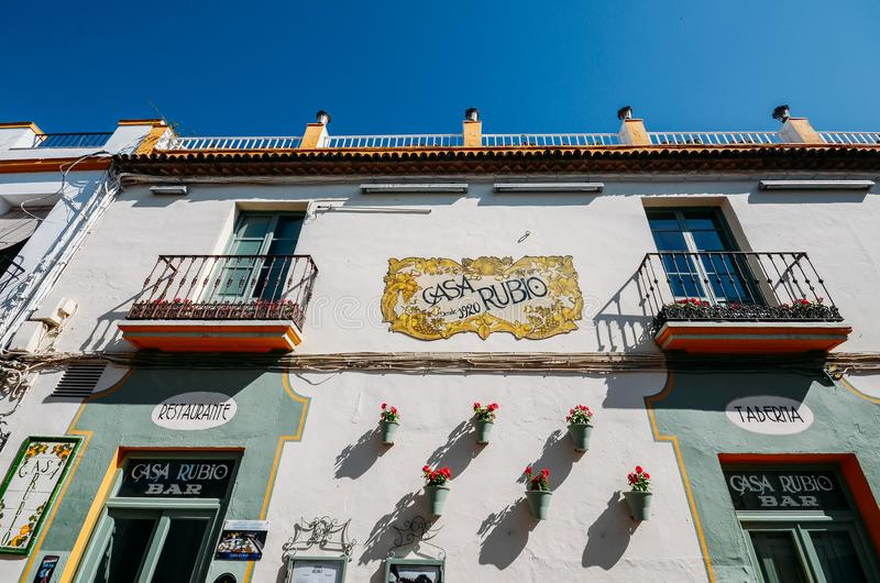 Facade of white limestone building covered in pots and plants, in the Jewish Quarter, which was declared a World. Cordoba, Spain - July 13, 2018: Facade of white stock photo