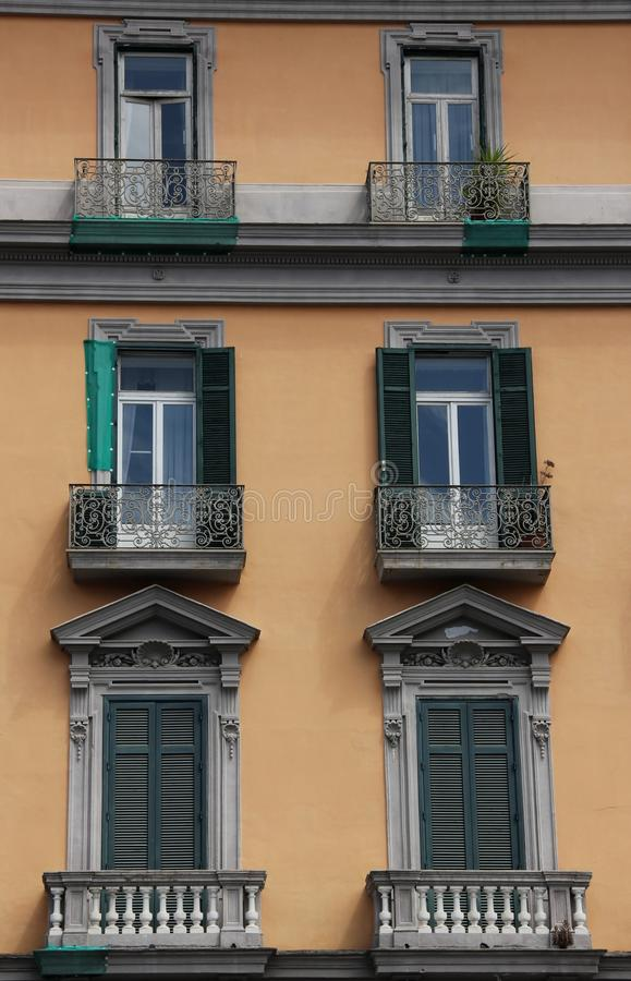 Facade. Window and balconies form the facade of a yellow building in Naples, Italy stock image