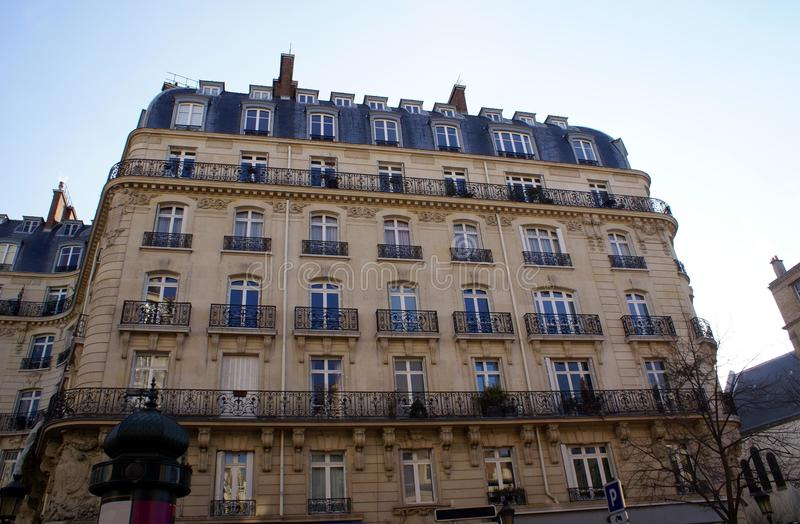 Facade of window balconies and sculptures. Old architecture of window balconies, dormer windows, railings, and sculptures royalty free stock image