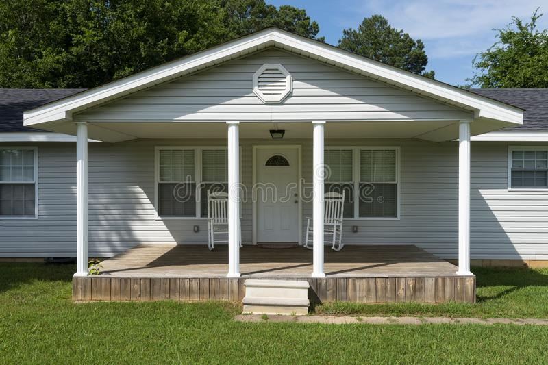 The facade of a wood house with a porch at a rural area of the State of Tennessee. USA stock image