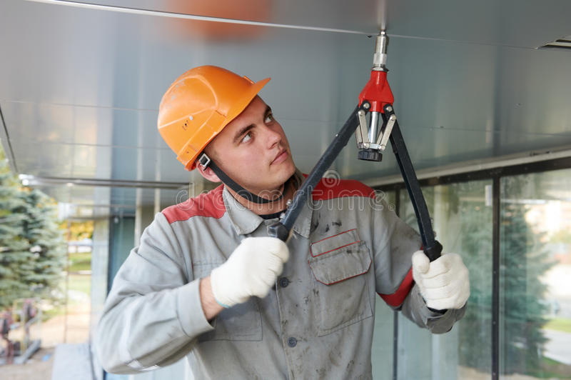 Download Facade Worker With Rivet Tool Stock Image - Image: 27323455