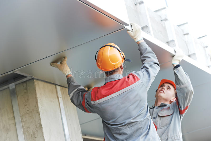 facade workers installing metal boarding stock photography. Black Bedroom Furniture Sets. Home Design Ideas