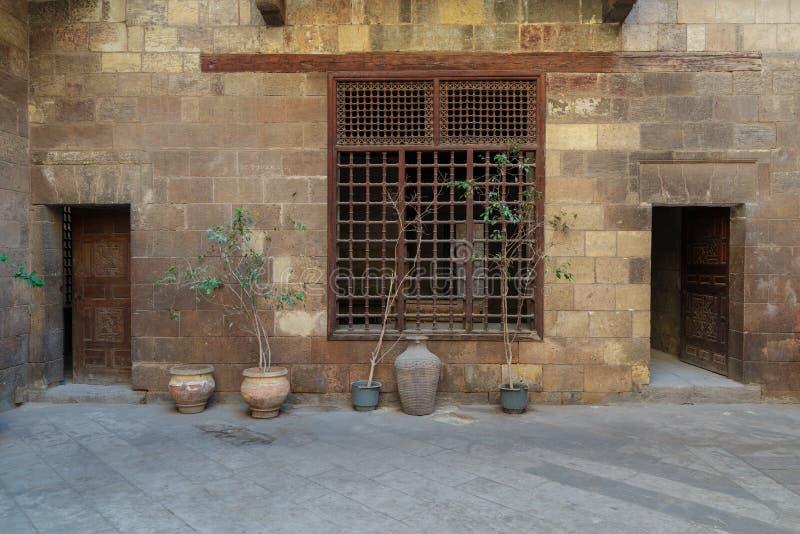 Facade of Zeinab Khatoun historic house, located near to Al-Azhar Mosqut, Old Cairo, Egypt. Facade of Zeinab Khatoun historic house, located near to Al-Azhar stock photography