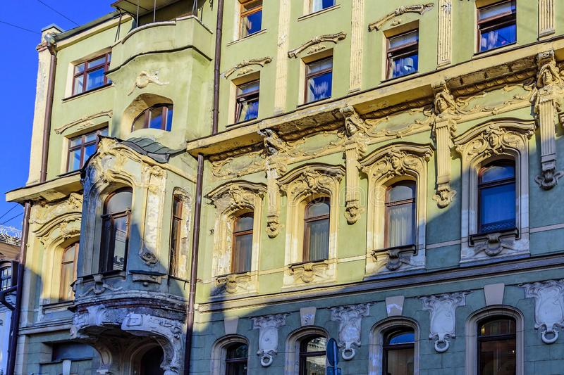 The facade, zrker, stucco very old building in the Empire style. City of Moscow, Petrovsky Lane 8, Russia.  royalty free stock photos