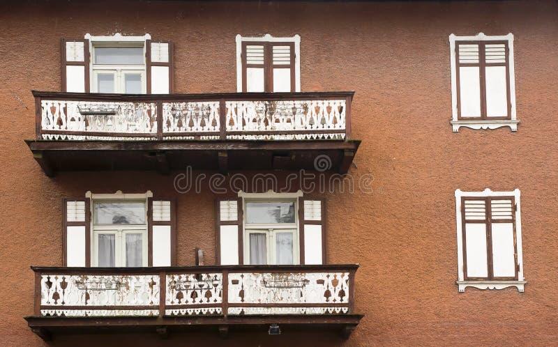 Facades and balconies, Cortina dAmpezzo, Italy royalty free stock photo